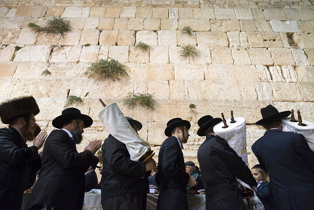 Orthodox Jews dancing with Torah scrolls during Simhat Torah festival, Western Wall, Jerusalem Old City, Israel, Middle East - 557-3413