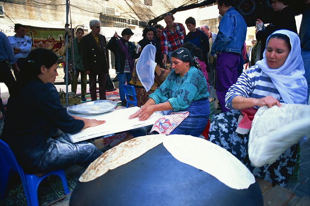 Bedouin making pita bread, Tel Aviv, Israel, Middle East