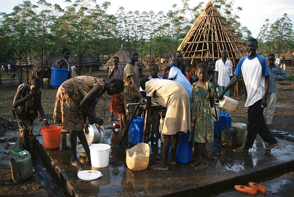 Women collecting water at the Dimma Refugee Camp, Ethiopia, Africa