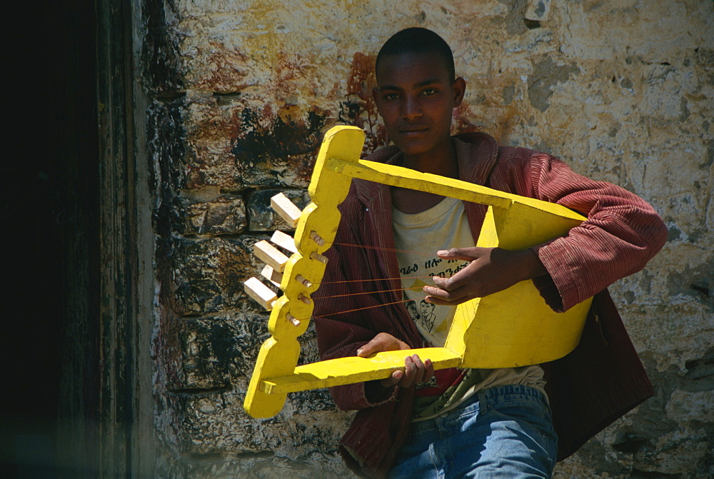 Boy playing handmade instrument, Mekele, Ethiopia, Africa