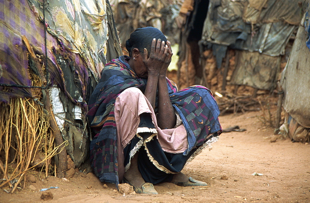 Portrait of woman in distress, Ethiopia, Africa