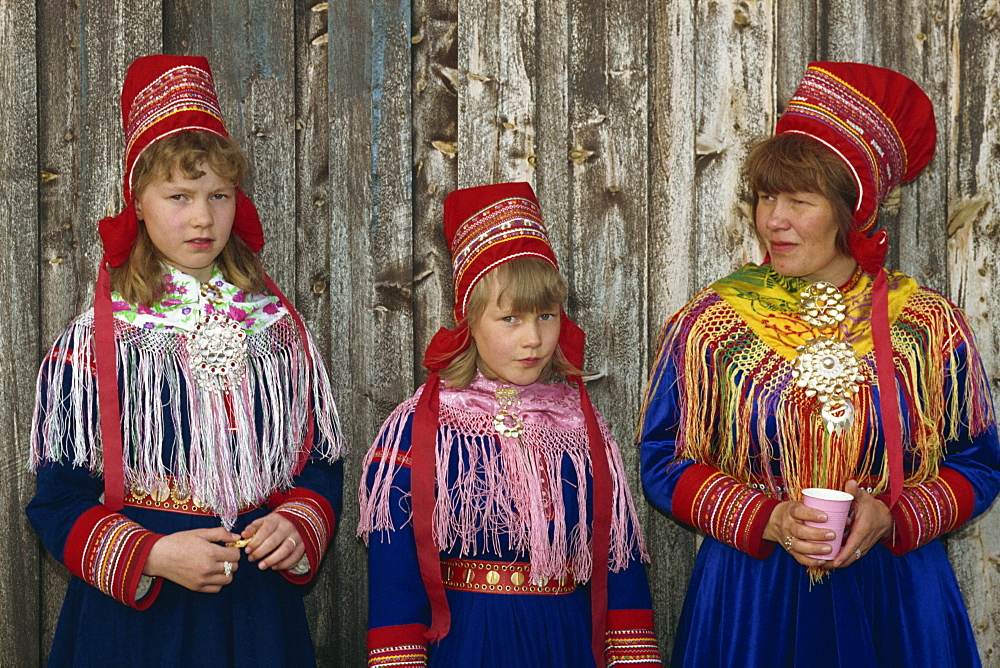 Portrait of Sami girls and woman, Lapps, in traditional costume for indigenous tribes meeting, at Karesuando, Sweden, Scandinavia, Europe