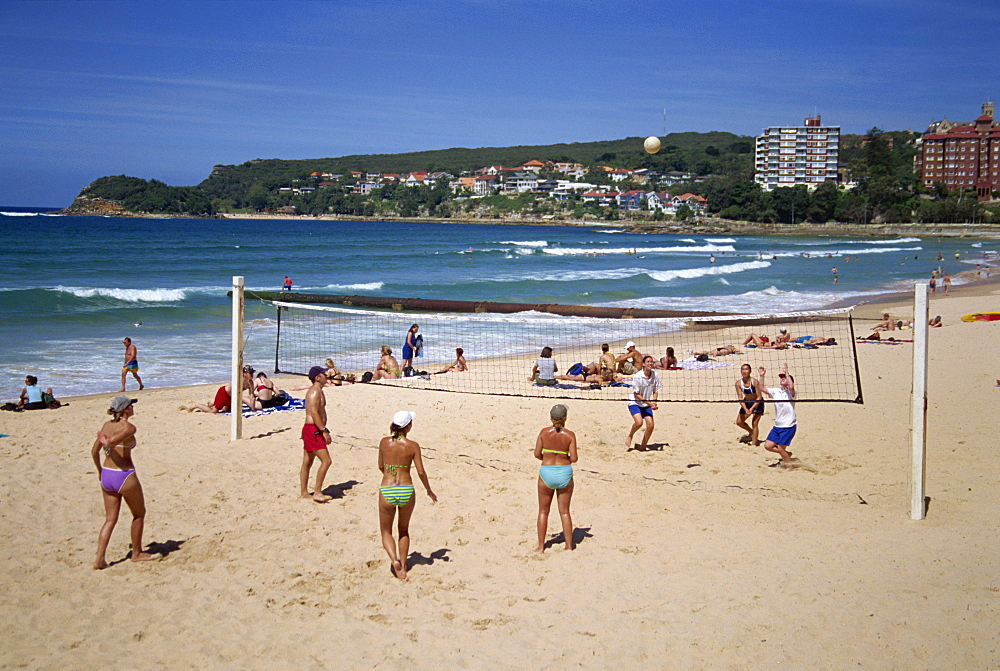 Men and women play volleyball on the beach at Manly, New South Wales, Australia, Pacific