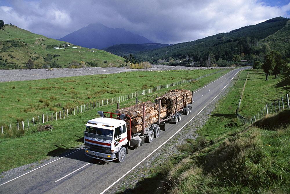 Logging trucks on the road near Gisborne, East Coast, North Island, New Zealand, Pacific