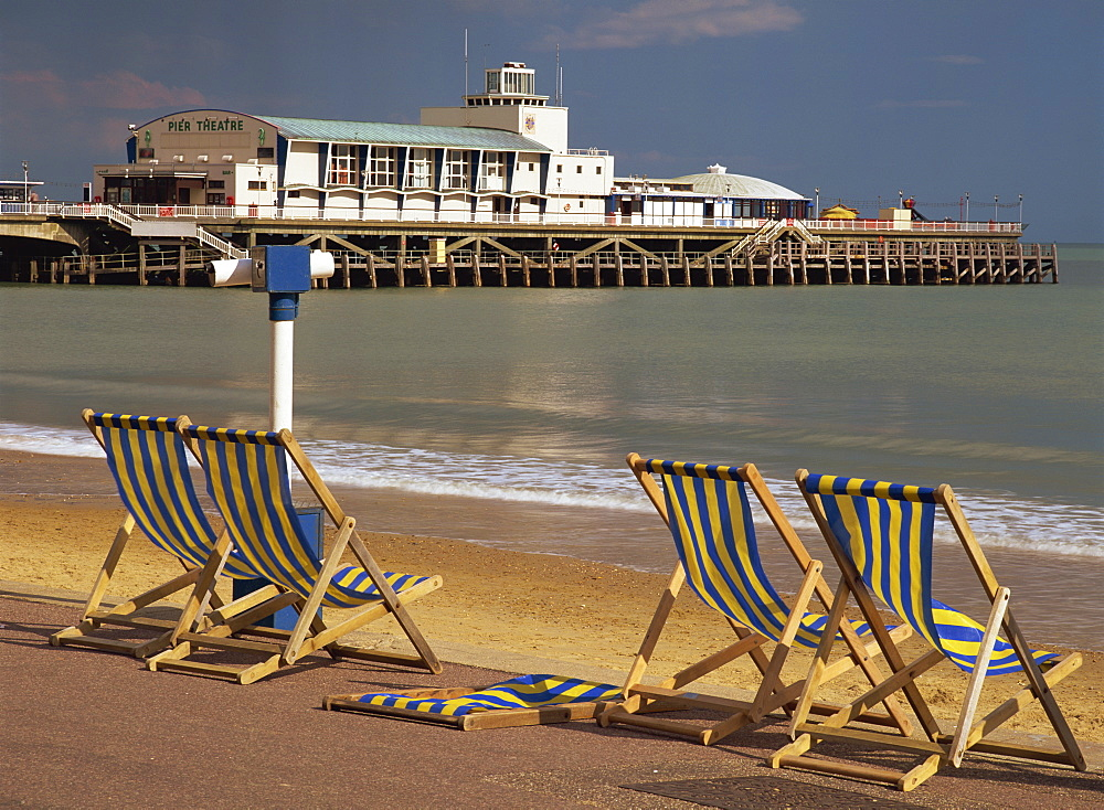 Deckchairs on the Promenade overlooking the deserted beach and Pier Theatre early in the summer season, West Cliff, Bournemouth, Dorset, England, United Kingdom, Europe