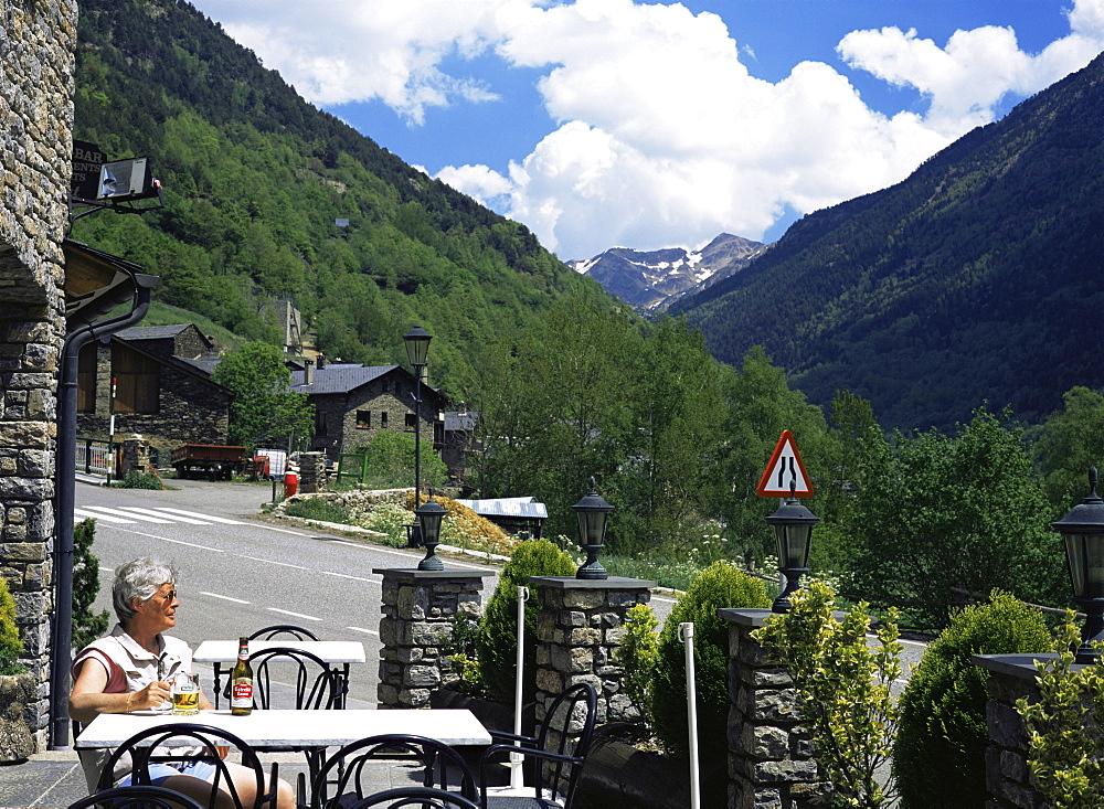 Tourist drinking beer in roadside bar, Llorts, Parish of Ordino, Ordino Valley, Andorra, Europe