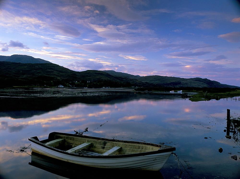 Dawn light over Glenelg, with rowing boat in the Glenelg River estuary during an unusually high tide, Glenelg, Highland region, Scotland, United Kingdom, Europe