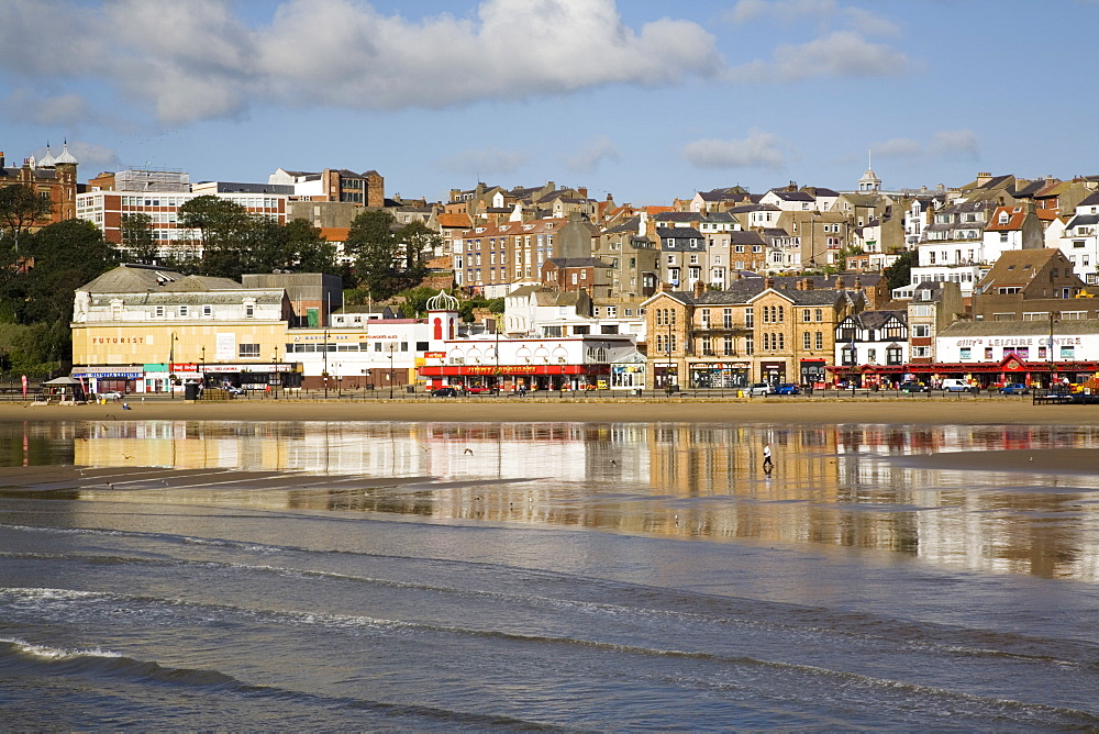 South Sands in South Bay at low tide with seafront buildings reflected in wet sand on beach, Scarborough, North Yorkshire, England, United Kingdom, Europe - 586-1374
