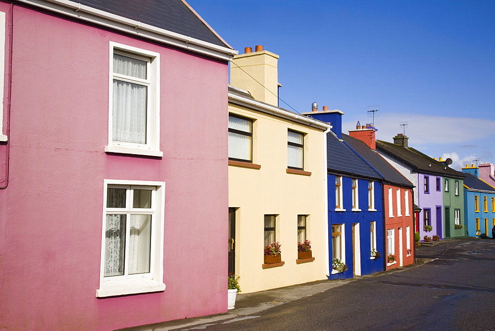 Row of colourful traditional houses in main street of historical village on Ring of Beara tourist route, Eyeries, Beara Peninsula, County Cork, Munster, Republic of Ireland, Europe - 586-1393