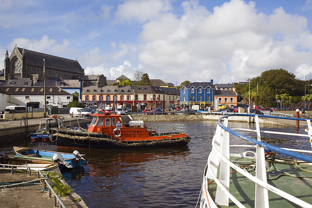 Lifeboat in harbour with town beyond, Castletown (Castletownbere) (Castletown Bearhaven), Beara Peninsula, County Cork, Munster, Republic of Ireland, Europe - 586-1399