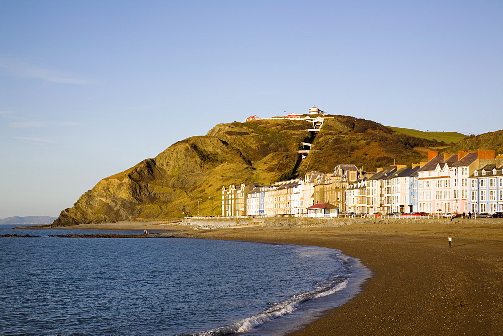 Colourful Victorian seafront buildings overlooking empty beach with funicular cliff railway on Constitution Hill in winter light, Aberystwyth, Ceredigion, Dyfed, Wales, United Kingdom, Europe - 586-1404