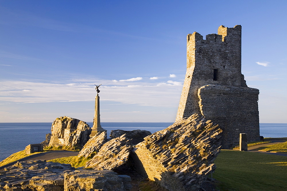 Ruins of 13th century castle and remains of Porth Newydd (New Gate) on Castle Point with War Memorial and sea beyond in low winter light, Aberystwyth, Ceredigion, Dyfed, Wales, United Kingdom, Europe - 586-1407