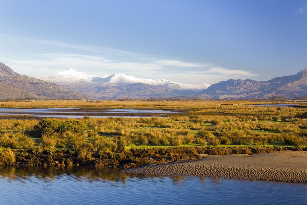 Afon Glaslyn River and Glaslyn Marshes, Site of Special Scientific Interest, with snow on mountains of Snowdon Horseshoe in winter, Porthmadog, Gwynedd, North Wales, United Kingdom, Europe - 586-1410
