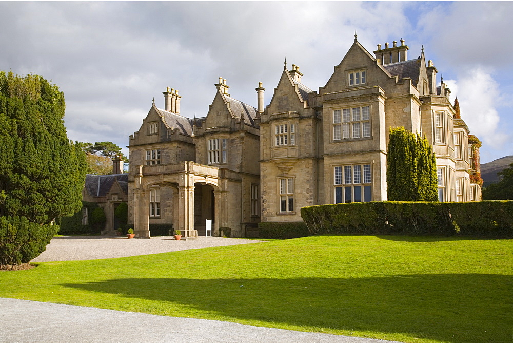 Front entrance and lawn of Muckross House built in 1843 in Victorian Tudor style by architect William Burn, Muckross Estate, Killarney National Park, County Kerry, Munster, Republic of Ireland, Europe - 586-1424