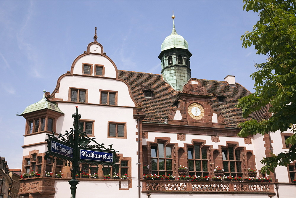 Ornate street sign and 16th century Altes Rathaus (Old City Hall) built 1559, Rathausgasse, Freiburg, Breisgau, Baden-Wurttemberg, Germany, Europe - 586-1491