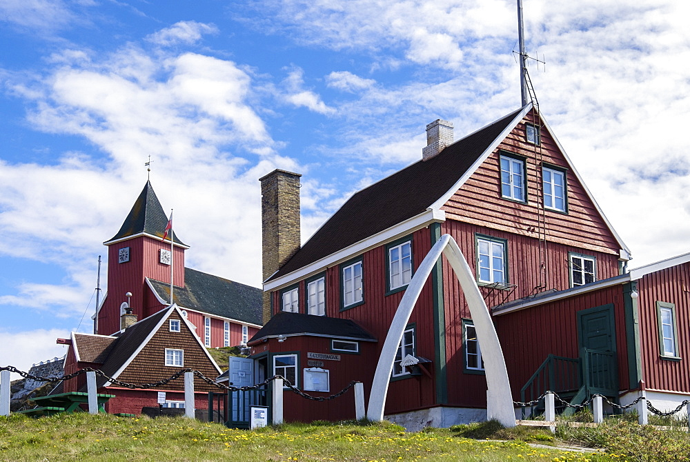 Colonial Manager's House 1846 and the new church with whalebone jaw arch, Sisimiut (Holsteinsborg), Qeqqata, Greenland, Polar Regions