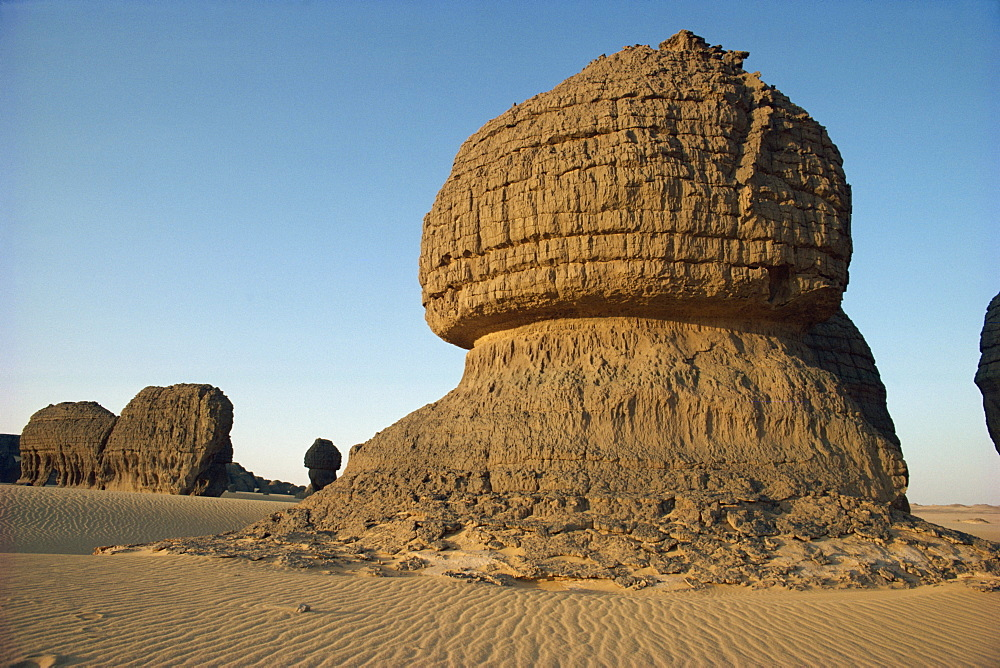 Wind eroded pinnacle rock showing strata, Tamegaout, Algeria, North Africa, Africa