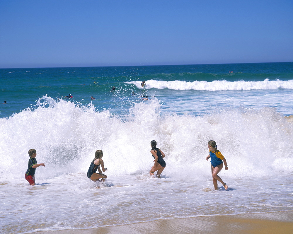 Children playing in the surf, Copacabana beach, near Gosford, north of Sydney, New South Wales, Australia, Pacific