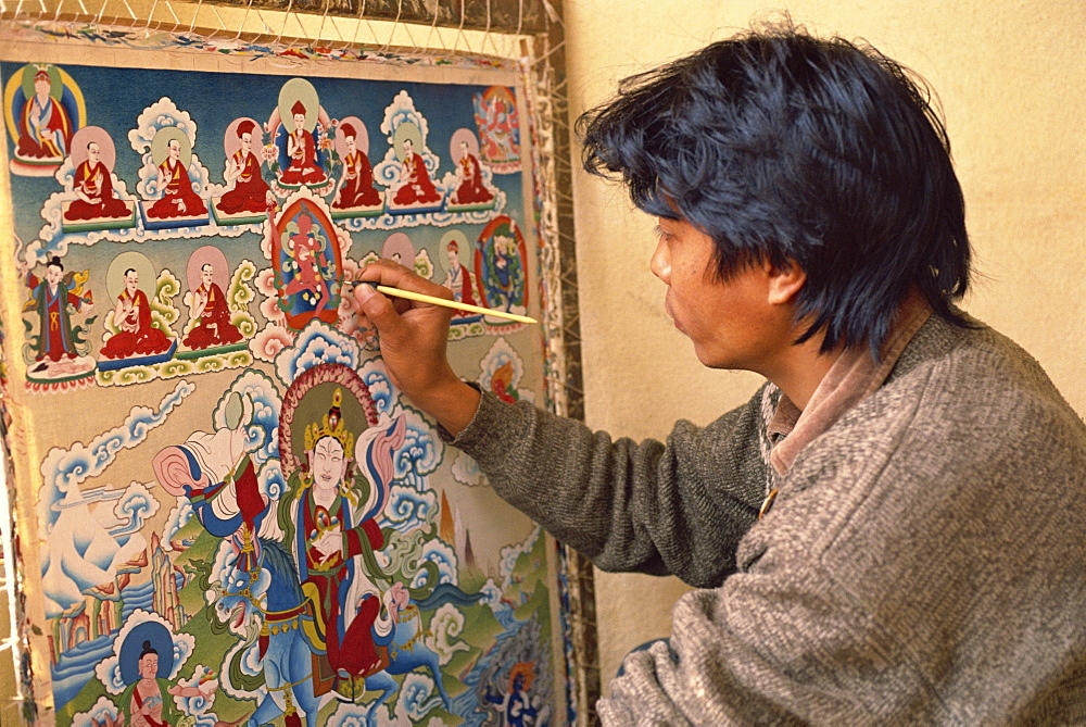 Head and shoulders of Thupten, a Tibetan thangka painter, tangka paintings are used in Buddhist meditation, in Kathmandu, Nepal, Asia