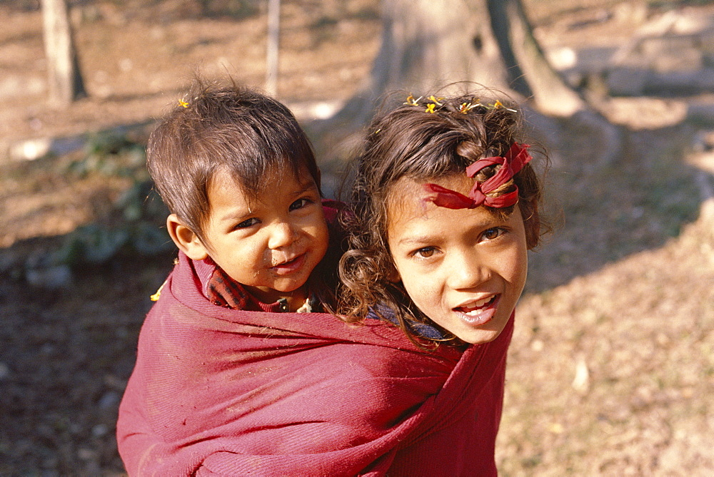 Head and shoulders portrait of two children, Kathmandu, Nepal, Asia