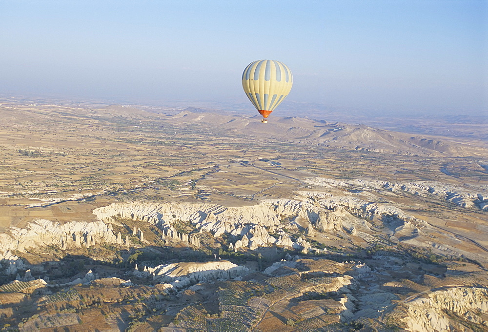 Hot air ballooning over rock formations, Cappadocia, Anatolia, Turkey, Asia Minor, Asia