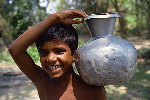 Boy carrying water, Bangladesh, Asia
