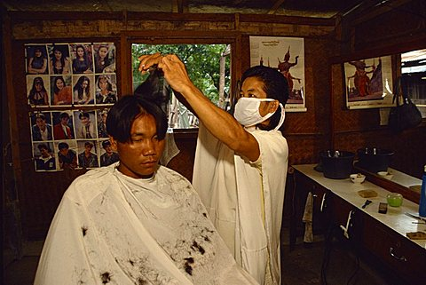 Lao barber, a returnee from camp in Thailand, Vientiane, Laos, Indochina, Southeast Asia, Asia - 640-2245