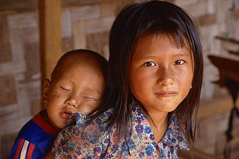 Hmong girl carrying her brother, Laos, Indochina, Southeast Asia, Asia - 640-2317