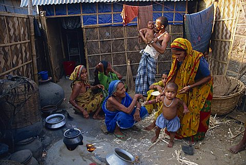 Families in the area outside their shack in a slum in the city of Dhaka (Dacca), Bangladesh, Asia
