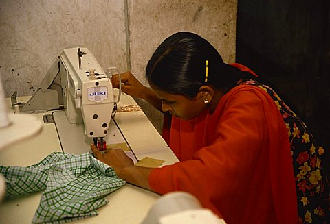Woman working in garment factory, Dhaka, Bangladesh, Asia