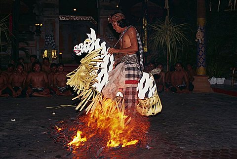 Portrait of a man riding a straw horse, walking on coals during fire dancing at night, Bali, Indonesia, Southeast Asia, Asia