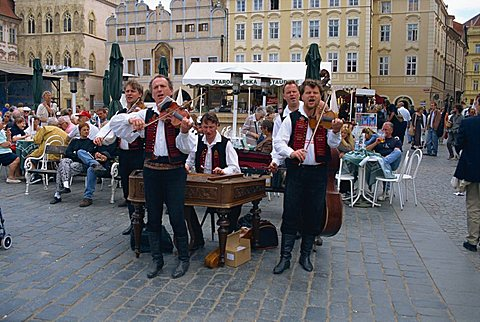 Musicians playing in city square, Prague, Czech Republic, Europe