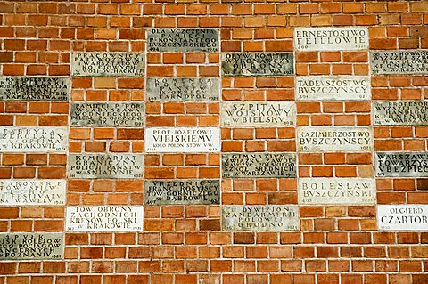 Names in the wall on way up to the Royal Castle area and Wawel Catherdral, Krakow (Cracow), UNESCO World Heritage Site, Poland, Europe