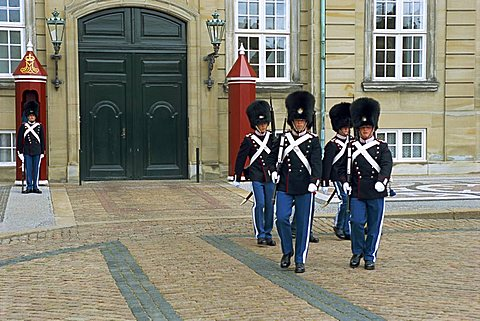 Changing the guard at the Royal Palace, Copenhagen, Denmark, Scandinavia, Europe