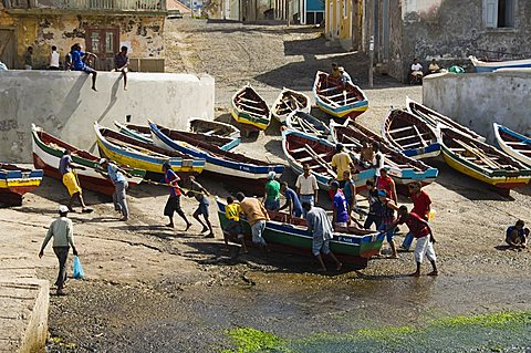 Fishermen taking boat out of water at the port of Ponto do Sol, Ribiera Grande, Santo Antao, Cape Verde Islands, Atlantic, Africa