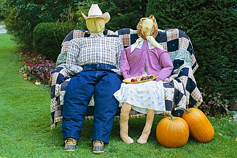 Strawdolls or scarecrows on a farm, Vermont, New England, United States of America (U.S.A.), North America