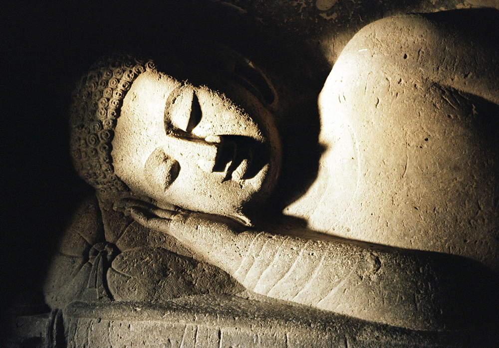 Detail of stone carving of the Buddha, Ellora Caves, UNESCO World Heritage Site, Maharashtra state, India, Asia