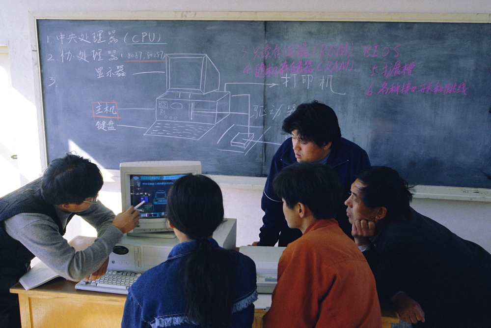 Students at a computer demonstration in a class at a rural school, China, Asia