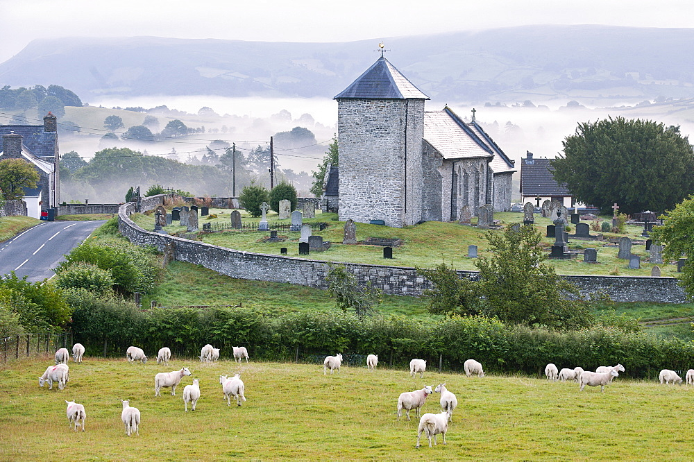 Early morning mist in the valleys surrounds St. David's Church, Llanddewi'r Cwm, Powys, Wales, United Kingdom, Europe - 663-806