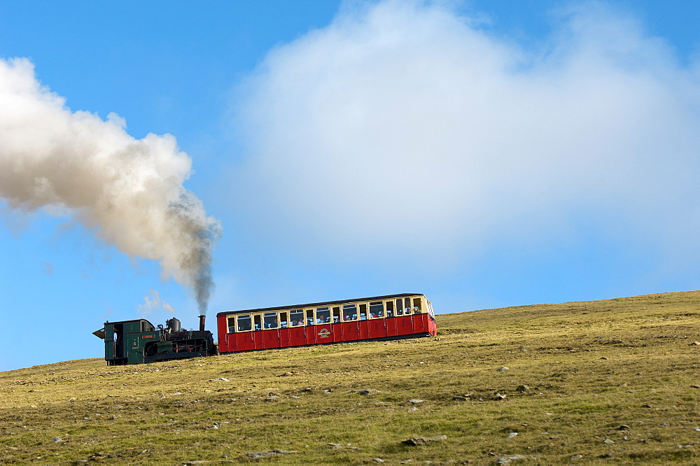 Steam train on route between Llanberis and the summit of Mount Snowdon in Snowdonia National Park, Gwynedd, Wales, United Kingdom, Europe - 663-821