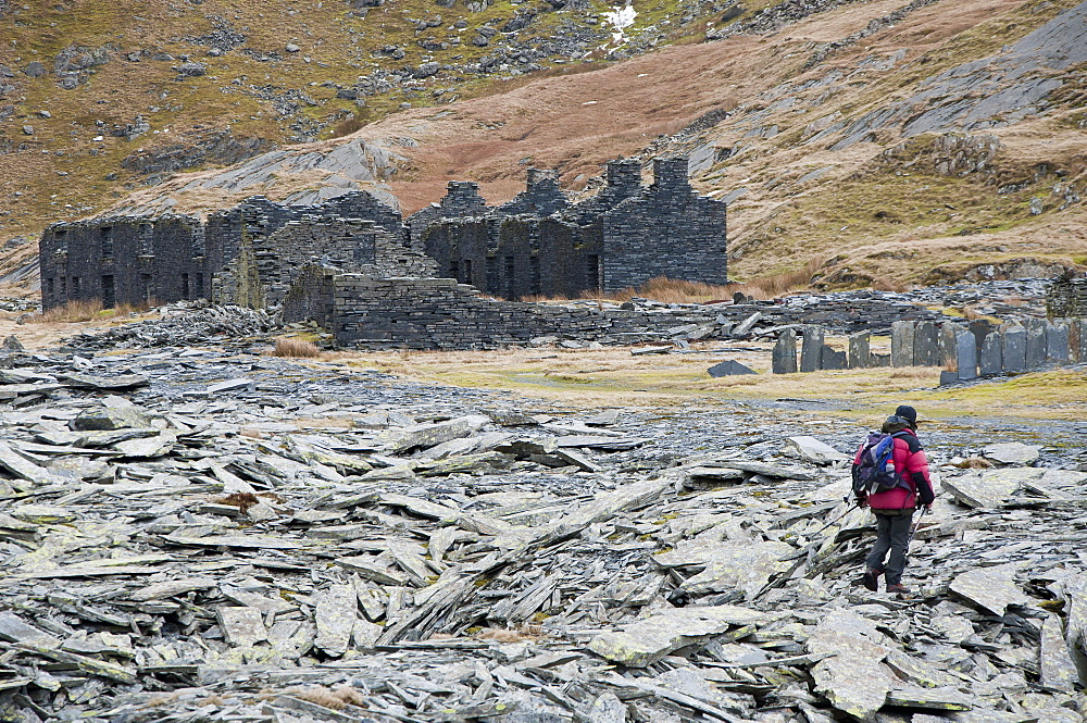 A hiker walks through the abandoned Croesor Slate Mines, Croesor, Gwynedd, Snowdonia National Park, Wales, United Kingdom, Europe - 663-835