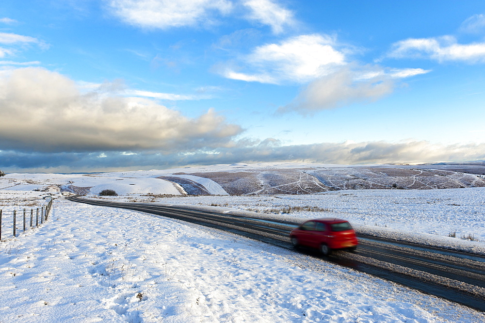 Motorists negotiate the B4520 road between Brecon and Builth Wells on the Mynydd Epynt moorland, Powys, Wales, United Kingdom, Europe