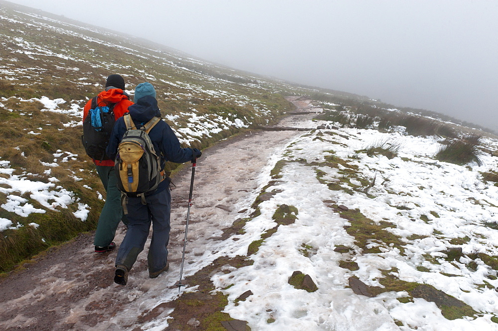 Hikers descend from Pen-Y-Fan summit in The Brecon Beacons National Park, Powys, Wales, United Kingdom, Europe - 663-859