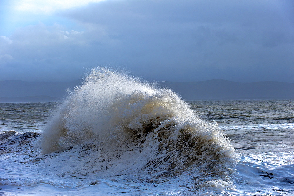 Huge waves crash against a stone jetty at Criccieth, Gwynedd, Wales, United Kingdom, Europe - 663-861