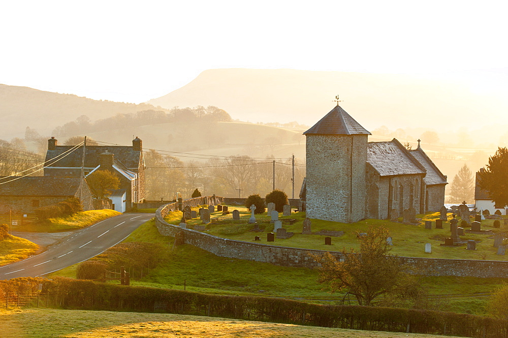 A view at sunrise of St. David's Church in the tiny hamlet of Llanddewi'r Cwm, Powys, Wales, United Kingdom, Europe - 663-864