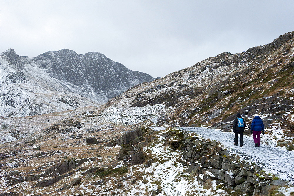 Hikers on the Miner's Track at base of Mount Snowdon in a wintry landscape in the Snowdonia National Park, Gwynedd, Wales, United Kingdom, Europe - 663-899