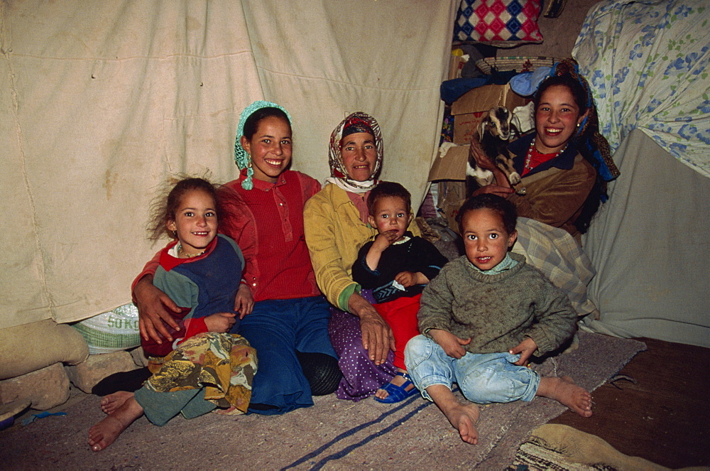 Portrait of a Berber family, women and children, inside a tent in the desert, southern Morocco, North Africa, Africa