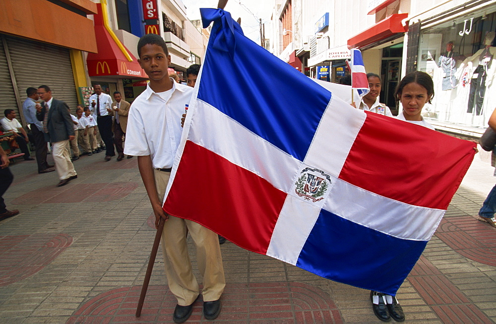 School children marching with flag, Santo Domingo, Dominican Republic, West Indies, Central America