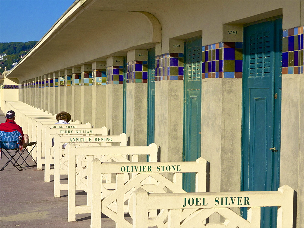 The famous Planches and the cabins of the Pompeian Baths with American actors' names painted, Deauville, Calvados, Normandy, France, Europe