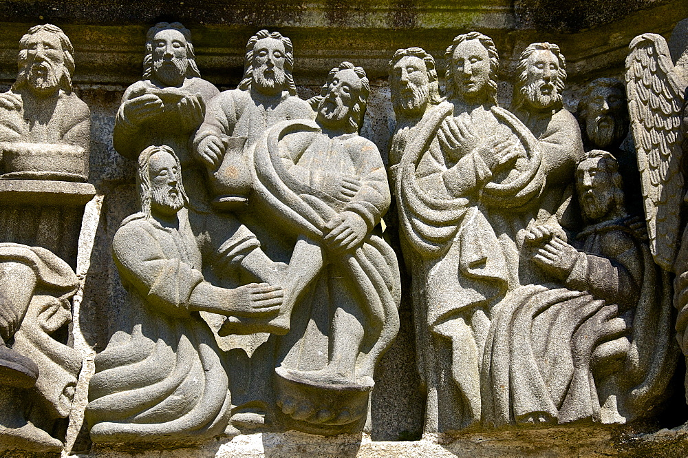 Calvary dating from between 1581 and 1588, detail showing washing of feet, Guimiliau parish enclosure, Finistere, Brittany, France, Europe